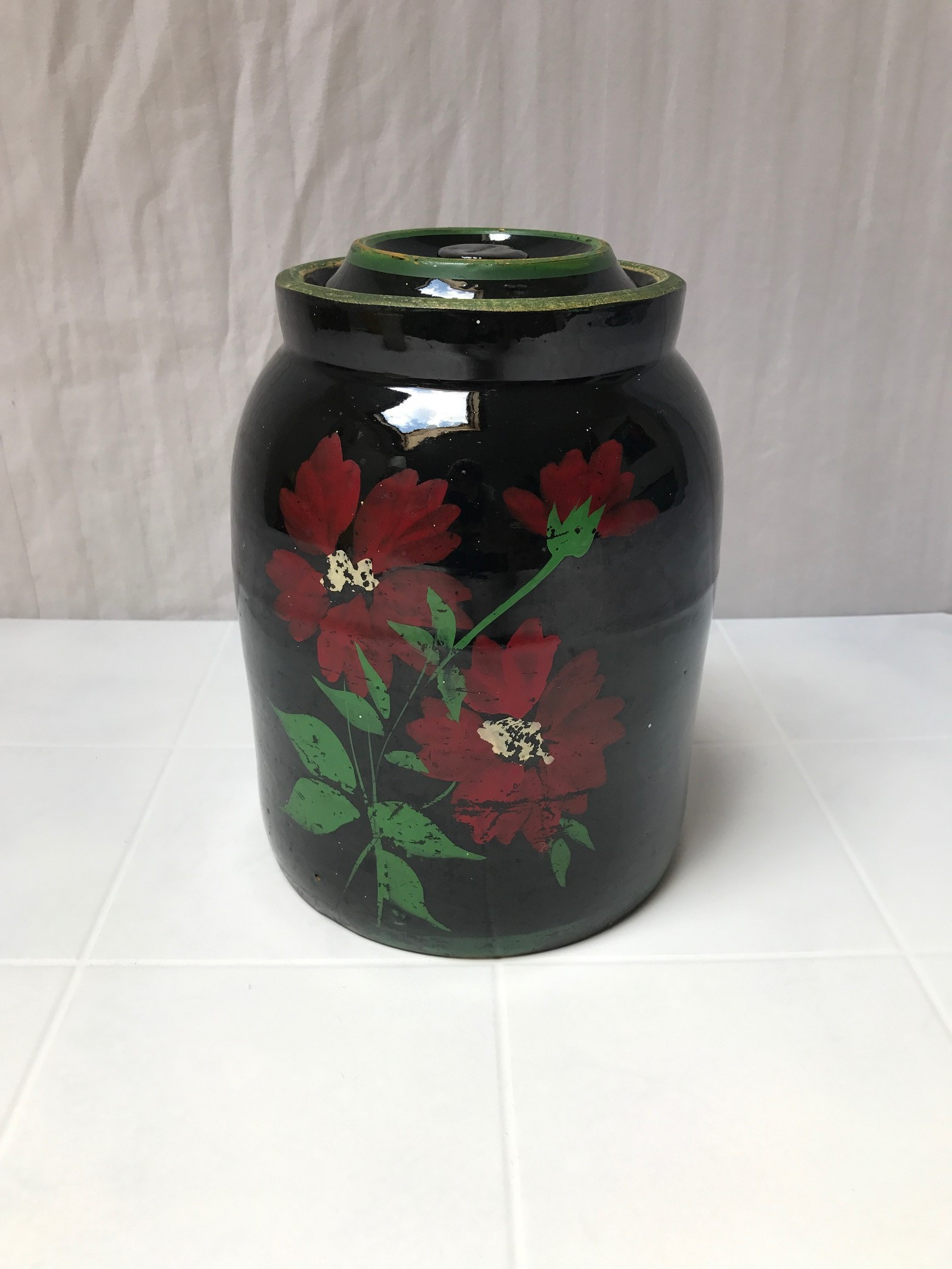 BLACK CANISTER COOKIE JAR WITH FLORAL DESIGN